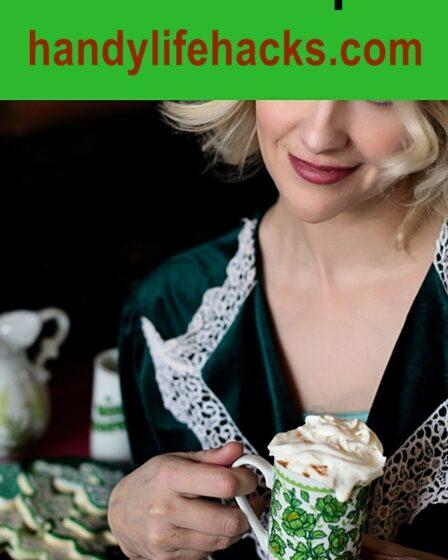 woman holding a cup of Irish Coffee
